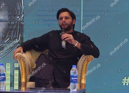 Retired Pakistani cricketer Shahid Afridi speaks during the launching ceremony of his biography at a shopping mall in Karachi, Pakistan