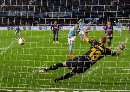 RC Celta's Iago Aspas scores their second goal on a penalty kick during a Spanish La Liga soccer match against Barcelona at the Balaidos stadium in Vigo, Spain