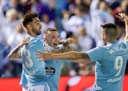 RC Celta's Iago Aspas is congratulated by teammates after scoring a goal during a Spanish La Liga soccer match between RC Celta and Barcelona at the Balaidos stadium in Vigo, Spain