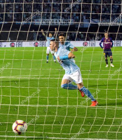 RC Celta's Iago Aspas celebrates after scoring a penalty shot during a Spanish La Liga soccer match between RC Celta and Barcelona at the Balaidos stadium in Vigo, Spain