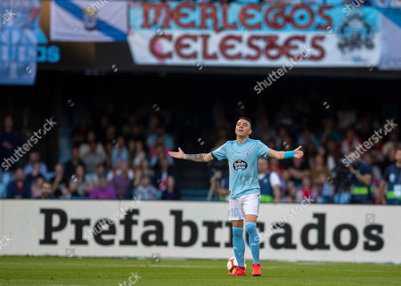 RC Celta's Iago Aspas gestures during a Spanish La Liga soccer match between RC Celta and Barcelona at the Balaidos stadium in Vigo, Spain