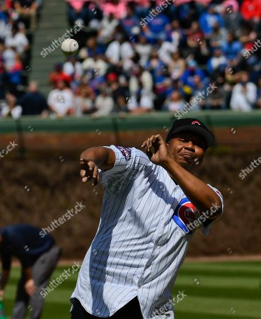Comedian Roy Wood Jr. throws out a ceremonial first pitch before a baseball game between the Chicago Cubs and the St. Louis Cardinals, in Chicago