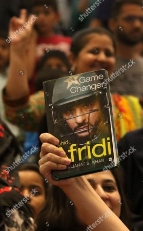 Supporters of Shahid Afridi, Pakistani Cricketer hold up his autobiography as he speaks to supporters during an event in Karachi, Pakistan, 04 May 2019. Pakistan all-rounder star, Shahid Afridi, launched his autobiography ?Game Changer?  describing his marvelous career, some controversial secrets and honest opinions about the Pakistan national cricket team.
