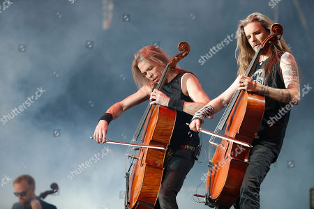 Stock Photo of Eicca Toppinen, left, and Perttu Kivilaakso. Eicca Toppinen, left center, and Perttu Kivilaakso, of Apocalyptica, perform at the Domination Music Festival in Mexico City