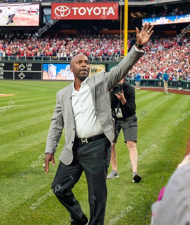 Former Philadelphia Phillies shortstop Jimmy Rollins waves to the crowd during his retirement ceremony before a baseball game against the Washington Nationals, in Philadelphia