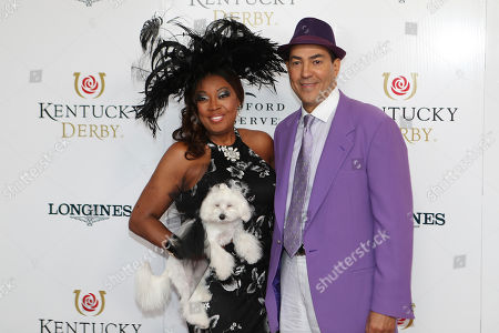 Star Jones, Ricardo Lugo and Mimi walk the red carpet before the 145th running of the Kentucky Derby horse race at Churchill Downs, in Louisville, Ky