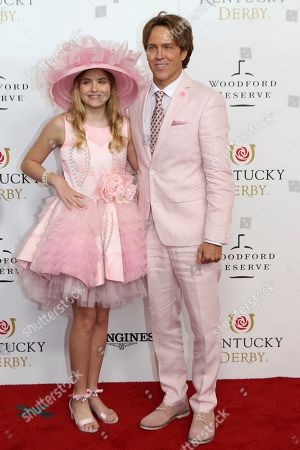 Larry and Dannielynn Birkhead walk the red carpet before the 145th running of the Kentucky Derby horse race at Churchill Downs, in Louisville, Ky