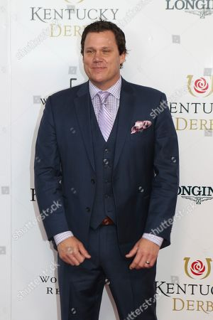 Bob Guiney walks the red carpet before the 145th running of the Kentucky Derby horse race at Churchill Downs, in Louisville, Ky