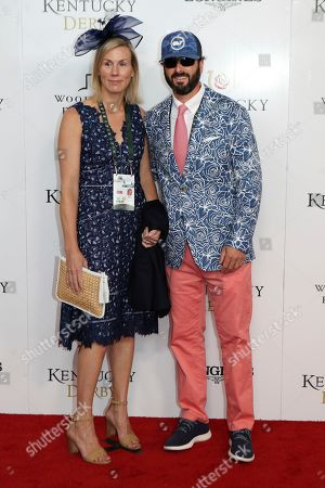 Ian Murray and guest walk the red carpet before the 145th running of the Kentucky Derby horse race at Churchill Downs, in Louisville, Ky
