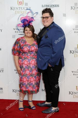Stock Image of Jordan and Kristen Smith walk the red carpet before the 145th running of the Kentucky Derby horse race at Churchill Downs, in Louisville, Ky