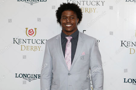 New York Jets Avery Williamson walks the red carpet before the 145th running of the Kentucky Derby horse race at Churchill Downs, in Louisville, Ky