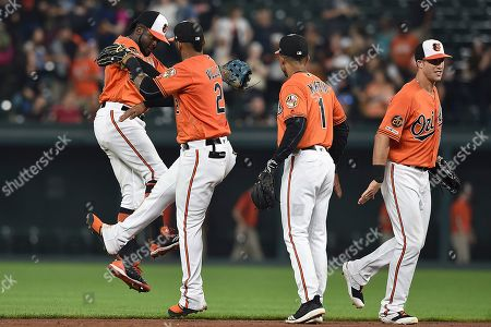 Baltimore Orioles, left to right, Dwight Smith Jr., Jonathan Villar, Richie Martin and Stevie Wilkerson celebrate their 3-0 win over the Tampa Bay Rays in a baseball game