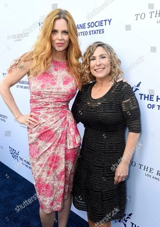 Kristin Bauer van Straten, Kitty Block. Kristin Bauer van Straten, left, and Kitty Block, President and CEO of the Humane Society of the United States and Humane Society International, walk the red carpet at the Humane Society of the United States' To the Rescue! Los Angeles gala. The gala was held at Paramount Studios and benefitted the HSUS' Farm Animal Protection campaign. The event honored GRAMMY-nominated pop superstar Kesha, Justice William A. Newsom III (posthumously) from the California Court of Appeal, and philanthropist Wallis Annenberg, in recognition of their steadfast support of animal welfare. Bellamy Young hosted the event which featured a performance by Leona Lewis