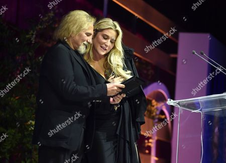Geezer Butler, Kesha. Geezer Butler, left, and Kesha speak at the Humane Society of the United States' To the Rescue! Los Angeles gala. The gala was held at Paramount Studios and benefitted the HSUS' Farm Animal Protection campaign. The event honored GRAMMY-nominated pop superstar Kesha, Justice William A. Newsom III (posthumously) from the California Court of Appeal, and philanthropist Wallis Annenberg, in recognition of their steadfast support of animal welfare. Bellamy Young hosted the event which featured a performance by Leona Lewis