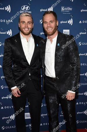 Gus Kenworthy, Matthew Wilkas. Gus Kenworthy, left, and Matthew Wilkas attend the 30th annual GLAAD Media Awards at the New York Hilton Midtown, in New York
