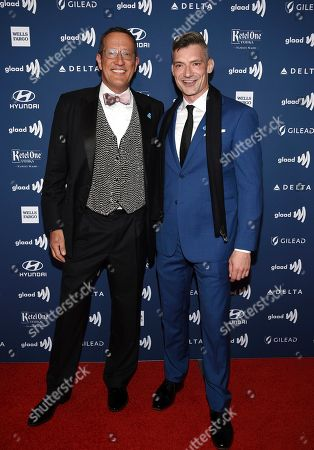Stock Image of CNN International anchor Richard Quest, left, and husband Chris attends the 30th annual GLAAD Media Awards at the New York Hilton Midtown, in New York