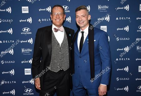 CNN International anchor Richard Quest, left, and husband Chris attends the 30th annual GLAAD Media Awards at the New York Hilton Midtown, in New York
