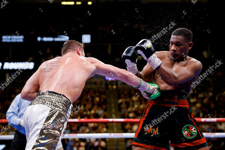 Canelo Alvarez, left, of Mexico, fights Daniel Jacobs during a middleweight title boxing match, in Las Vegas
