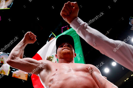 Canelo Alvarez, of Mexico, celebrate his win over Daniel Jacobs in a middleweight title boxing match, in Las Vegas