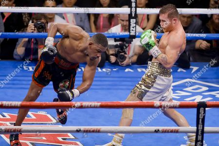 Canelo Alvarez, right, of Mexico, fights Daniel Jacobs in a middleweight title boxing match, in Las Vegas