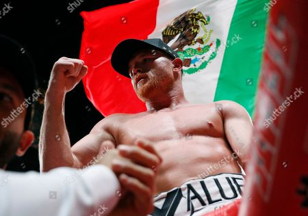Canelo Alvarez, of Mexico, celebrates after defeating Daniel Jacobs in a middleweight title boxing match, in Las Vegas