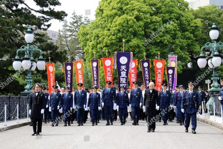 Stock Photo of Wellwishers visit the Imperial Palace to meet Emperor Naruhito and Empress Masako to celebrate enthronement of the new Emperor Naruhito. Former Emperor Akihito abdicated on April 30 and Crown Prince Naruhito ascended the throne on May 1.