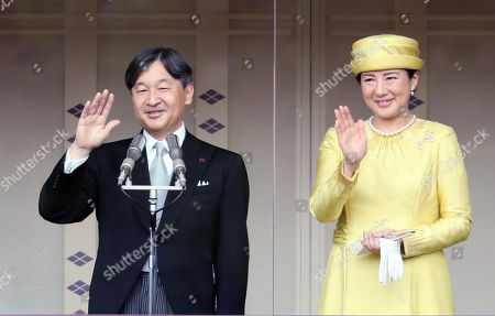 Stock Image of Japanese Emperor Naruhito accompanied by Empress Masako waves his hand to wellwishers gathered for the celebration of enthronement of the new Emperor Naruhito. Former Emperor Akihito abdicated on April 30 and Crown Prince Naruhito ascended the throne on May 1.