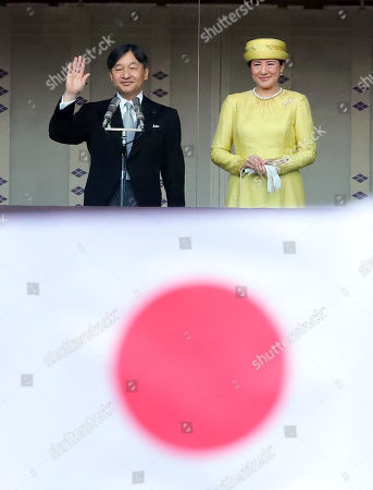 Stock Picture of Japanese Emperor Naruhito accompanied by Empress Masako waves his hand to wellwishers gathered for the celebration of enthronement of the new Emperor Naruhito. Former Emperor Akihito abdicated on April 30 and Crown Prince Naruhito ascended the throne on May 1.