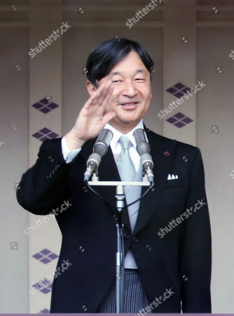 Japanese Emperor Naruhito waves his hand to wellwishers gathered for the celebration of enthronement of the new Emperor Naruhito. Former Emperor Akihito abdicated on April 30 and Crown Prince Naruhito ascended the throne on May 1.