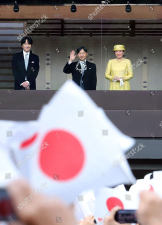 Japanese Emperor Naruhito accompanied by Empress Masako and his younger brother Prince Akishino delivers a waves his hand to wellwishers gathered for the celebration of enthronement of the new Emperor Naruhito. Former Emperor Akihito abdicated on April 30 and Crown Prince Naruhito ascended the throne on May 1.