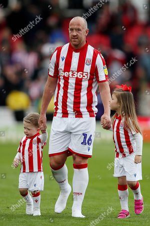Charlie Adam of Stoke City with his family at the end of the match