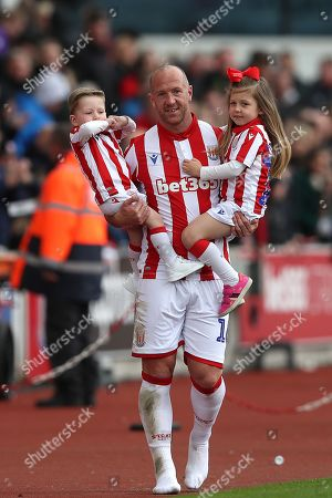 Charlie Adam of Stoke City with his family on the pitch at the end of the match