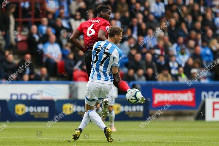 Manchester United midfielder Paul Pogba (6) flicks the ball around Huddersfield Town defender Erik Durm (37) during the Premier League match between Huddersfield Town and Manchester United at the John Smiths Stadium, Huddersfield