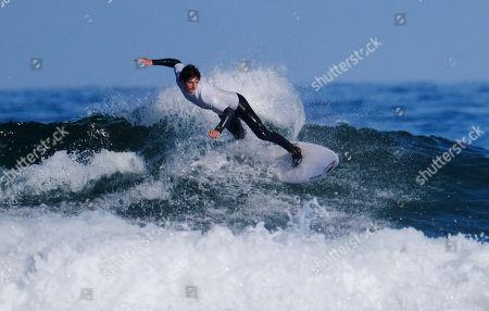 Stock Image of Seth Morris surfing the Men's Open Heat 3