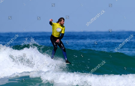 Stock Photo of Ben Skinner surfing the Men's Longboard Heat 3