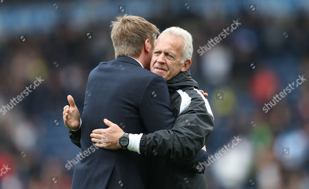 Swansea City manager Graham Potter,left, with Alan Curtis at the end of the match