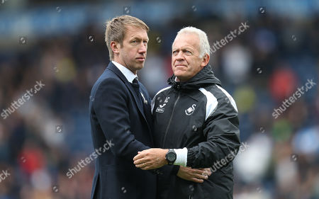 Swansea City manager Graham Potter, left, with Alan Curtis at the end of the match