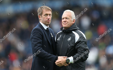 Swansea City manager Graham Potter,left,with Alan Curtis at the end of the match