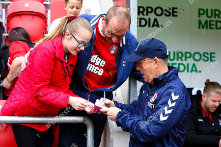 Middlesbrough manager Tony Pulis sings an autograph for a young Rotherham United fan