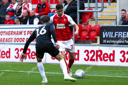 Joe Newell of Rotherham United looks to get past Jonathan Howson of Middlesbrough