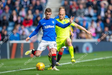 Jonathon Flanagan (#15) of Rangers FC clears the ball ahead of David Gray (#2) of Hibernian FC during the Ladbrokes Scottish Premiership match between Rangers FC and Hibernian FC at Ibrox, Glasgow