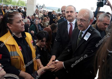 Turkey's main opposition Republican People's Party leader Kemal Kilicdaroglu speaks with family members before attending funeral prayers for Celaleddin Ozdemir, 35, a Turkish army officer killed in an attack by Syrian Kurdish militants in Syria on Saturday, in Ankara, Turkey