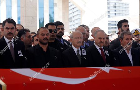 Turkey's main opposition Republican People's Party leader Kemal Kilicdaroglu, center, attends funeral prayers for Celaleddin Ozdemir, 35, a Turkish army officer killed in an attack by Syrian Kurdish militants in Syria on Saturday, in Ankara, Turkey
