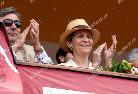 Princess Elena de Borbon (R), the Spanish king's sister, applauds her daughter Victoria Federica de Marichalar (unseen), who is taking part in the traditional Carriage Exhibition at Real Maestranza bullring during the 2019 April Fair festival in Seville, southern Spain, 05 May 2019. Tourists and locals, wearing the traditional colorful attire,  can enjoy the 'sevillanas' dance, music and food during the week-long April Fair.