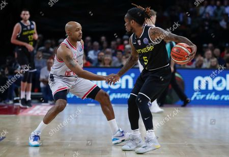 Stock Photo of Ricky Hickman of Brose Bamberg (L) and Paris Lee of Telenet Giants Antwerp fight for the ball during the match for the third place between German team Brose Bamberg and Belgian team Telenet Giants Antwerp at the basketball Final Four Champions League tournament in Antwerp, Belgium, 05 May 2019.