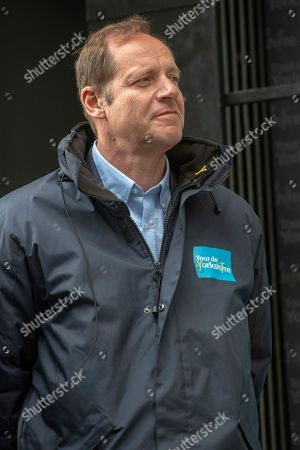 Christian Prudhomme on stage in Leeds during stage four of the Tour de Yorkshire from Halifax to Leeds,