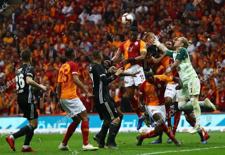 Galatasaray's Ryan Donk (C) in action against Besiktas' goalkeeper Loris Karius (R) during the Turkish Super League soccer match between Galatasaray and Besiktas in Istanbul, Turkey, 05 May 2019.