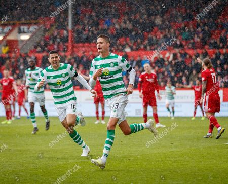 Mikael Lustig of Celtic celebrates after scoring with a diving header to give Celtic a 0-1 lead. Lustig's team mate Tom Rogic chases after him, left.