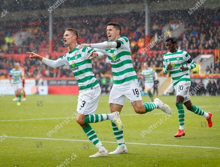 Mikael Lustig of Celtic celebrates after scoring with a diving header to give Celtic a 0-1 lead. Lustig's team mate Tom Rogic chases after him, right.