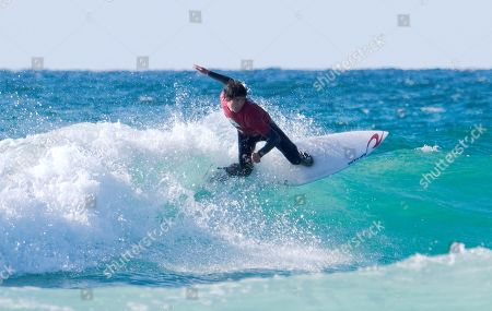 Stock Picture of Seth Morris surfing in the Men's Open Final at the Caravan & Motorhome Club English National Surfing Championships held at Perranporth.